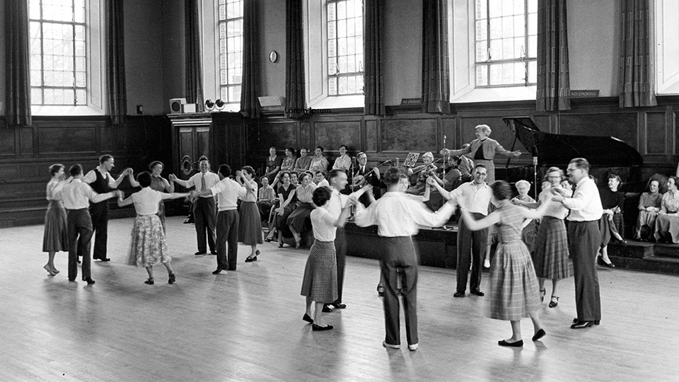 historical photo of a busy social dance in Kennedy Hall
